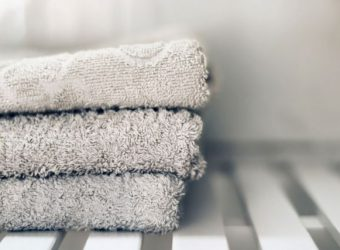 White towels piled in a sink.